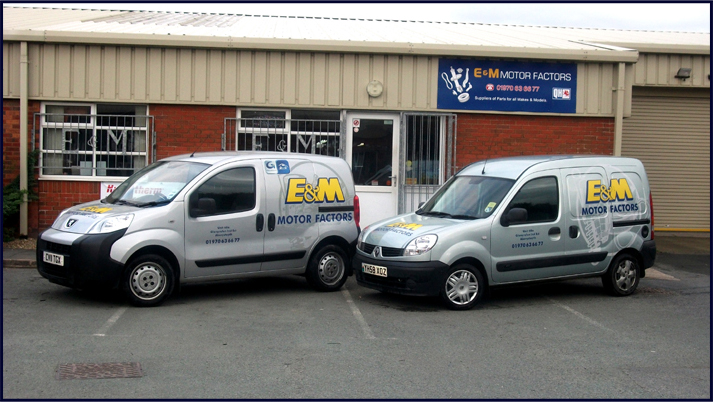 E and M Delivery Vans outside the Aberystwyth Shop